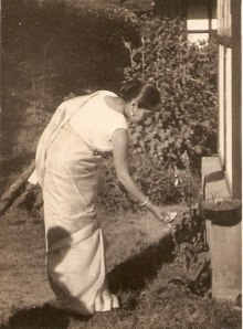 Oma admiring her rose garden.  This photo was taken when she was much younger.